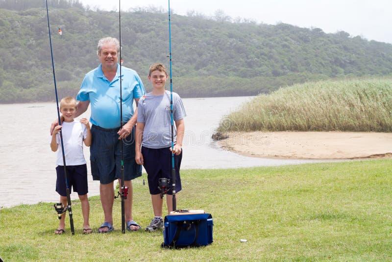 Grandfather grandsons fishing