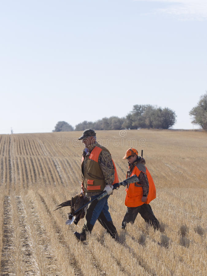 Grandfather and Grandson hunting. Grandfather and Grandson out pheasant hunting stock photo