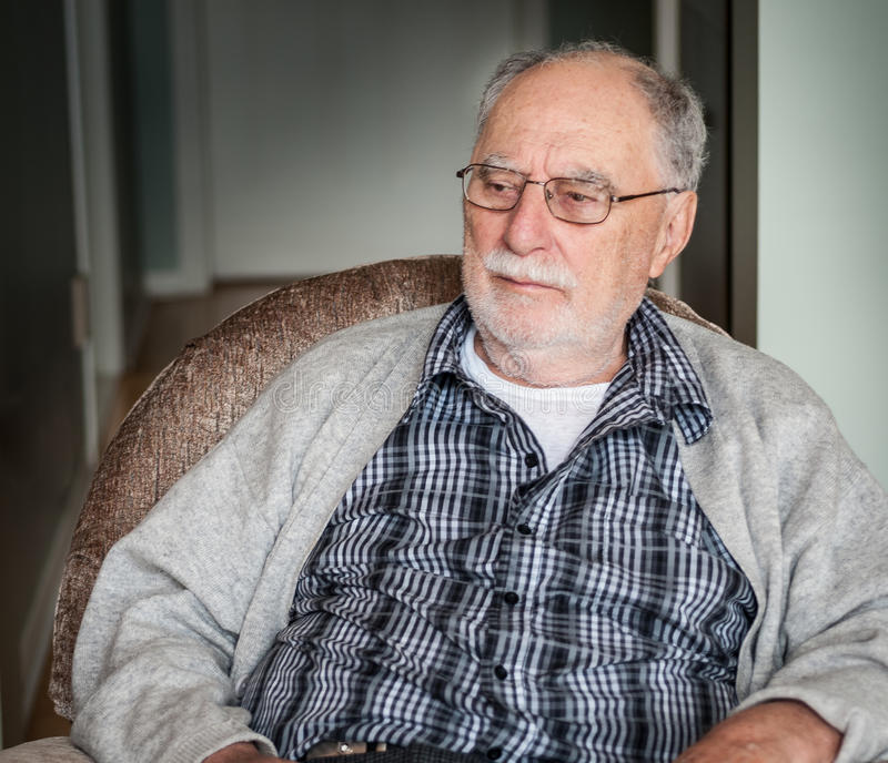 Grandfather with a gray sweater stock photos