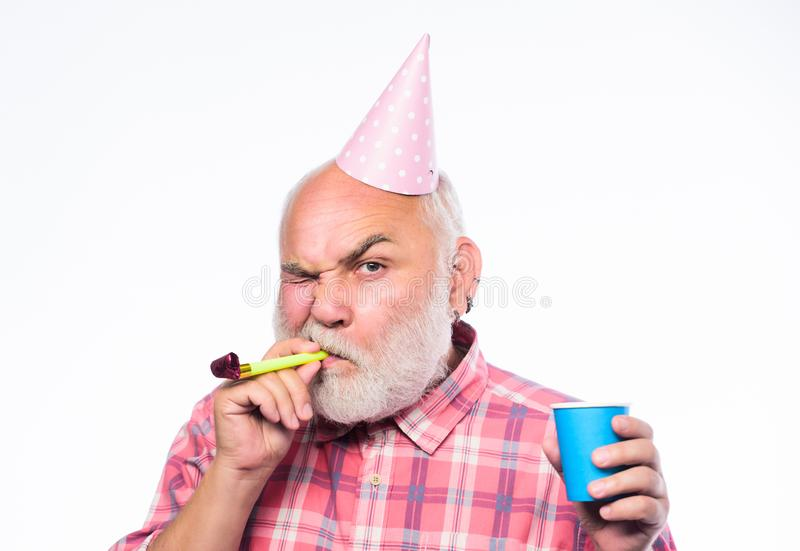 Grandfather graybeard blowing party whistle. Getting older is still fun. Elderly people. Birthday concept. Ideas for. Seniors birthday celebrations. Man bearded stock photography