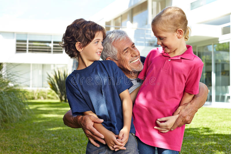 Grandfather having fun with grandchildren royalty free stock photography