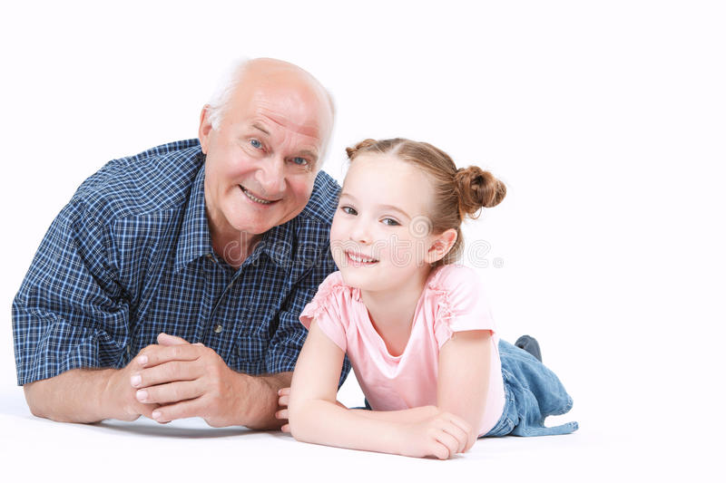 Grandfather having fun with his granddaughter stock photo