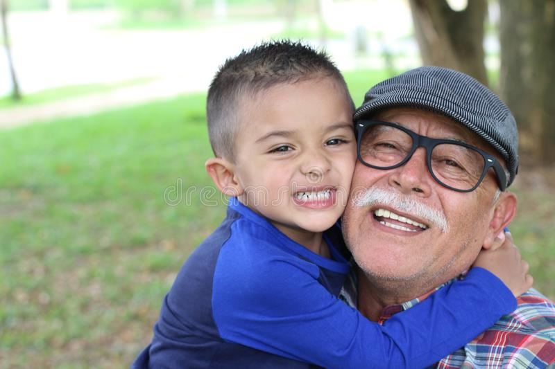 Grandfather having a fun with his grandson royalty free stock photos