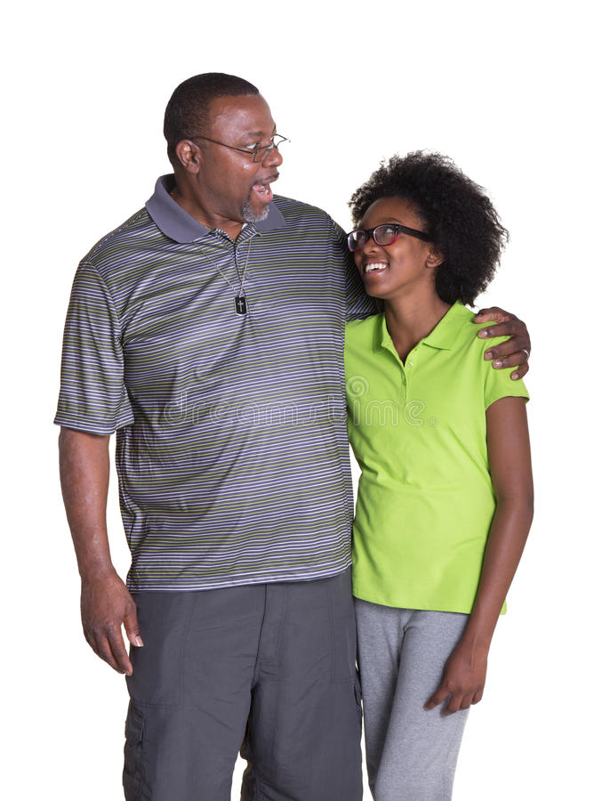 A grandfather and his teenage granddaughter royalty free stock photography