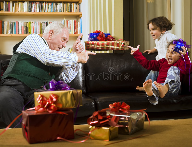 Grandfather playing royalty free stock image