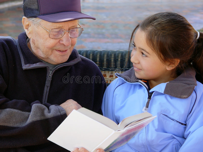 Grandfather reading royalty free stock photo