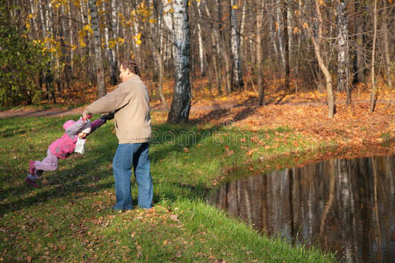 Download Grandfather Rotates  Granddaughter  In Wood Royalty Free Stock Image - Image: 7346256