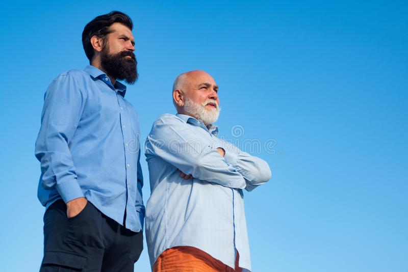 Grandfather with son in park. Family generation: future dream and people concept. Grandpa retiree. Fathers day. Grandfather with son in park. Family generation royalty free stock photo