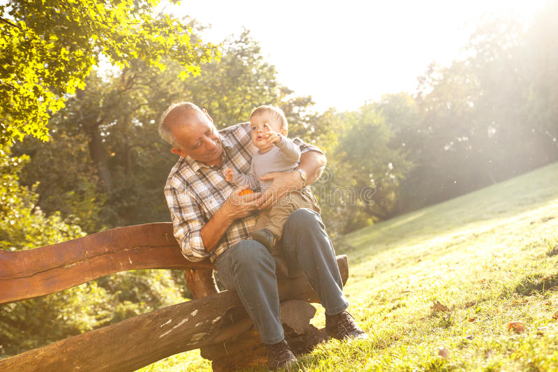 Grandfather spending time with his grandson stock images