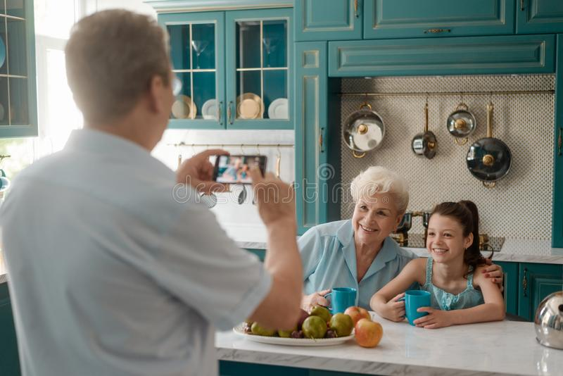 Grandfather taking a picture royalty free stock images