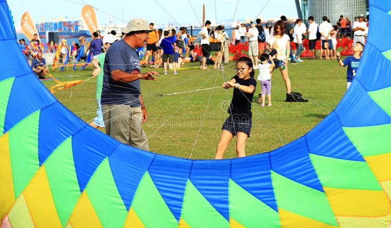 Grandfather is teaching granddaughter flying kite royalty free stock photos