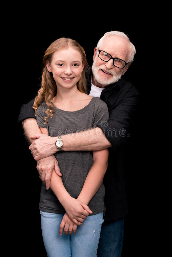 Teenage Granddaughter Helping Grandfather Out On Walk -4826