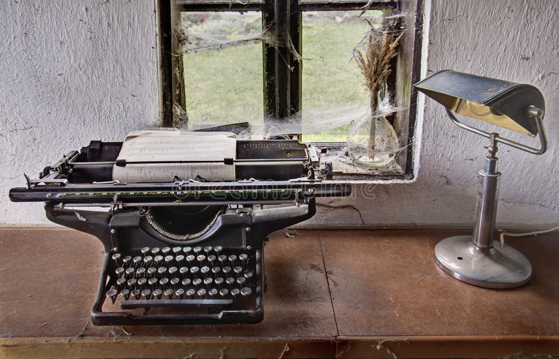 Retro workshop. This is retro typewriter and lampe stock photography