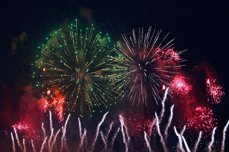 Grandiose beautiful multi-colored fireworks royalty free stock photography