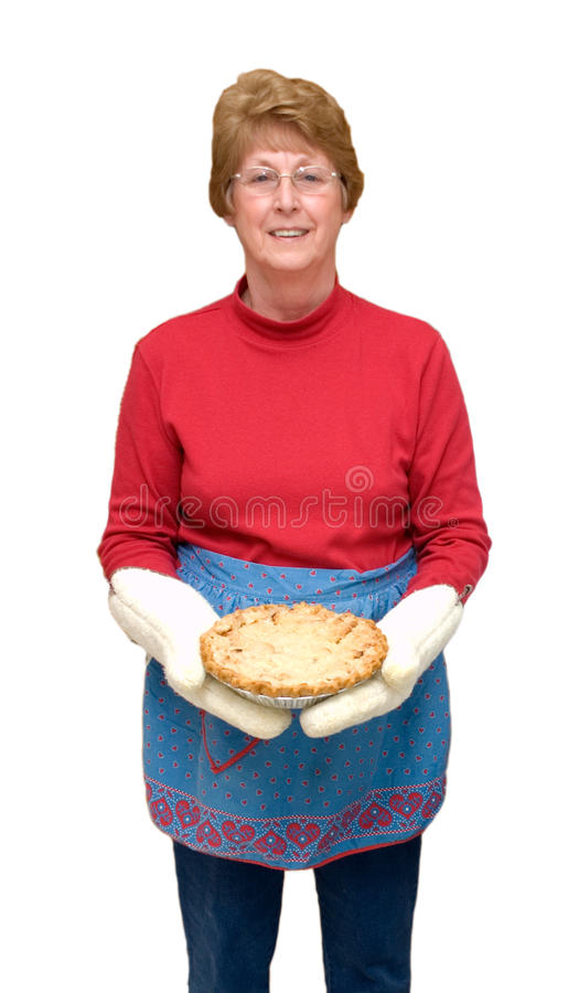 Grandma Baking Apple Pie, Home Cooking Isolated. Grandma shows off her fresh baked apple pie. Tasty home cooking! Isolated image. Friendly, smiling, happy stock image