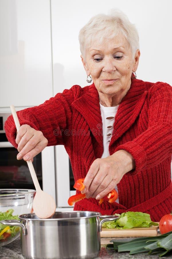 Grandma cooking stock image