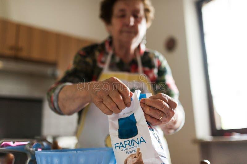 Grandma cooking local italian food royalty free stock photos