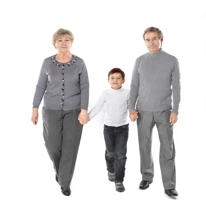 Grandma and grandpa go with her grandson.isolated on white background.  royalty free stock photography