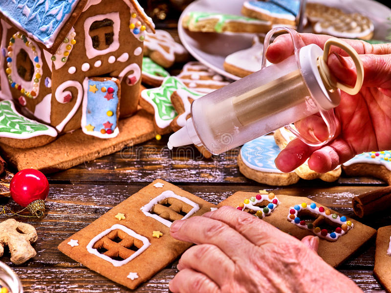Grandma makes a gingerbread house. royalty free stock photos