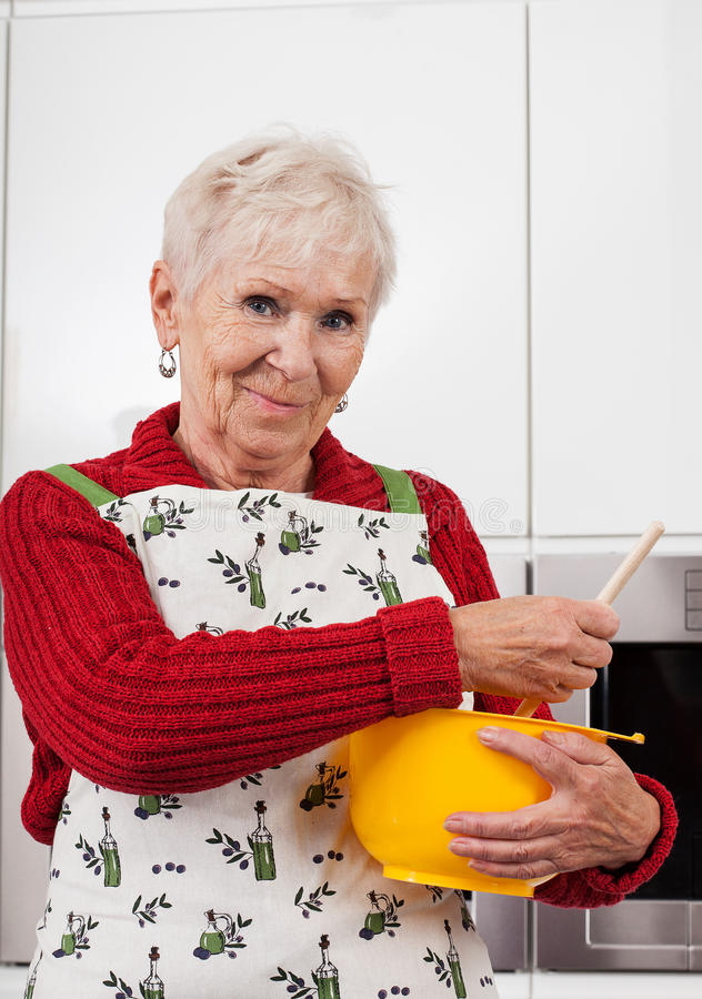 Grandma making a pie royalty free stock photos