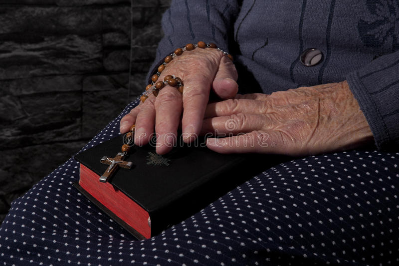 Grandma praying. stock images