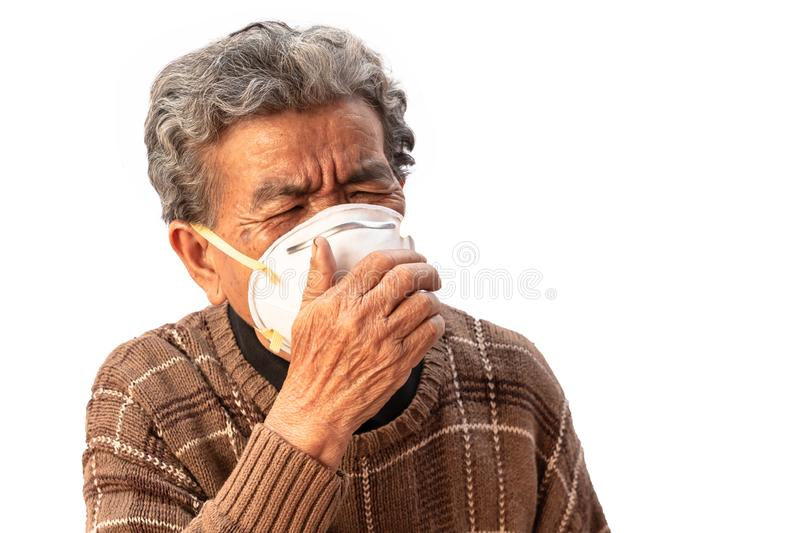 Grandma uses a mask to prevent dust isolated on white background stock photo