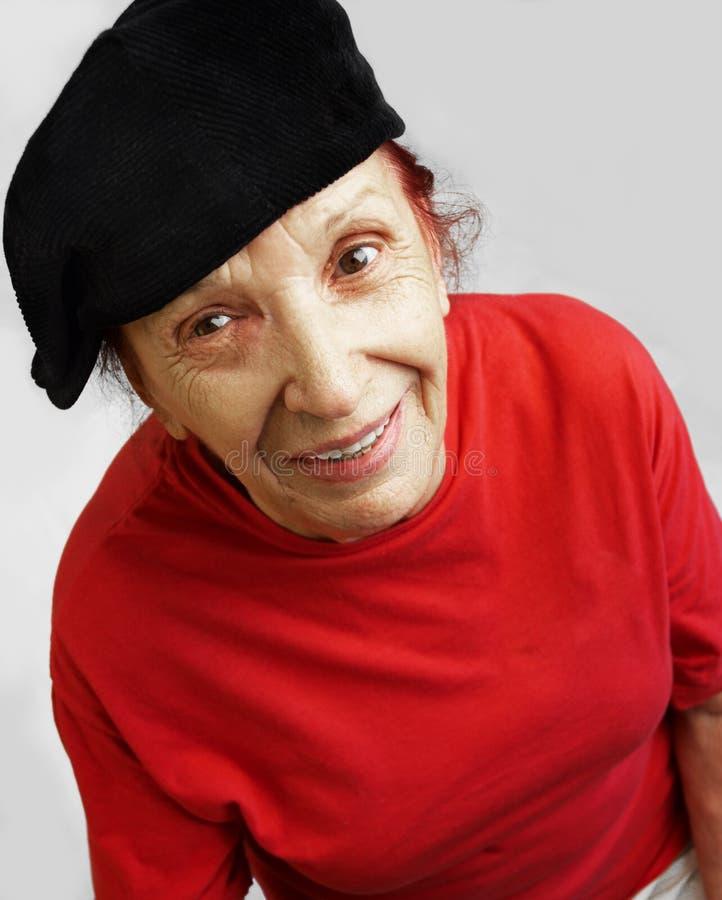 Grandmama actif dans le capuchon noir photos stock