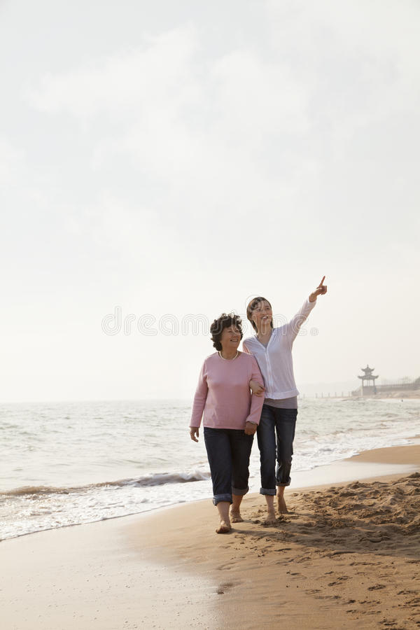 Free Grandmother And Granddaughter Taking A Walk By The Beach Stock Image - 31694341