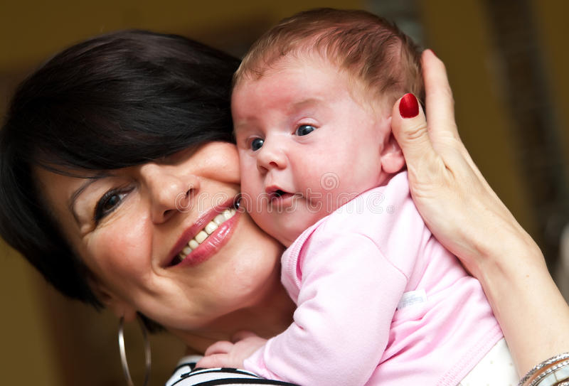 Download Grandmother with baby girl stock image. Image of face - 14365379