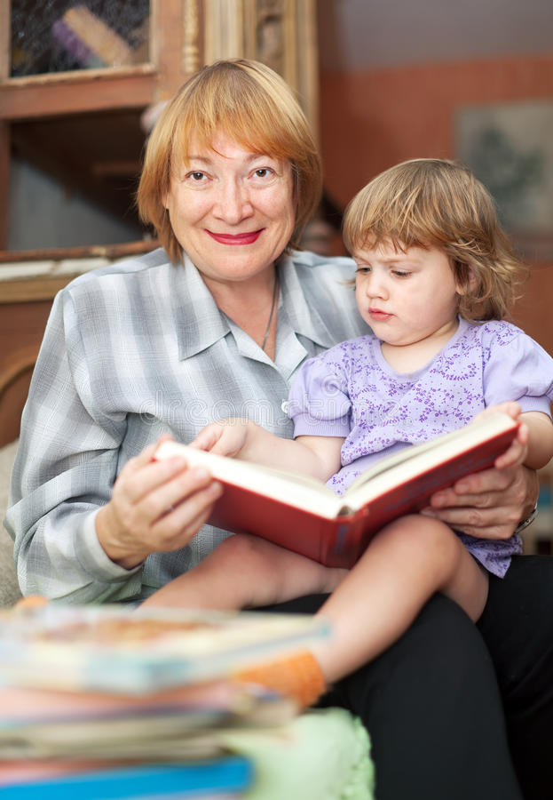 Download Grandmother And Baby Reading Book Royalty Free Stock Photo - Image: 27615755