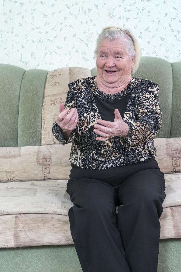 Grandmother beckons to her stock photo