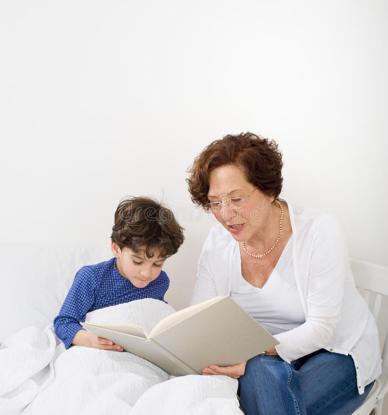 Download Grandmother bed time story stock image. Image of elderly - 13689703