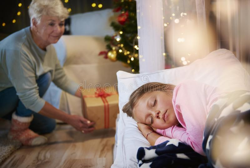 Grandmother bringing a christmas present royalty free stock images