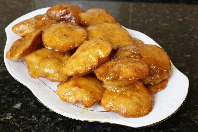 Grandmother cakes a homemade sweet fried with honey. Grandmother`s cakes a homemade sweet fried with honey, typical of Andalusian and Spanish cuisine. Grandma`s stock photos