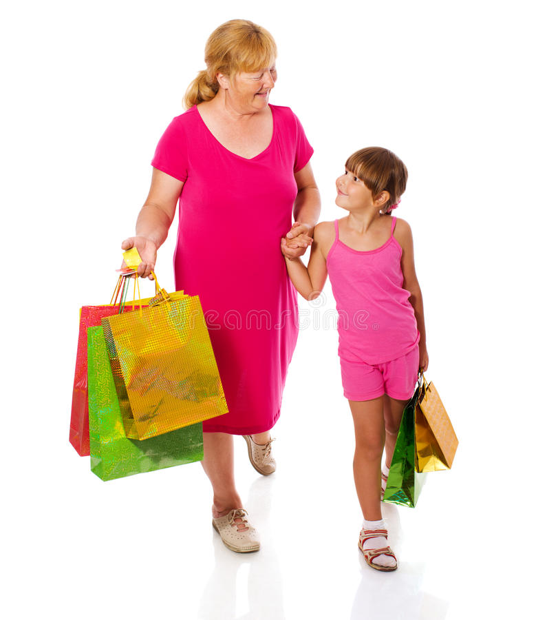 Grandmother with child. Go shopping isolated stock photo
