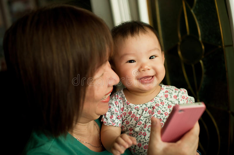 Grandmother and child smiling. During a light moment stock image
