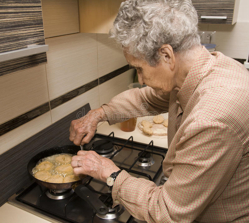Download Grandmother at cooking stock image. Image of sear, senescence - 23737425