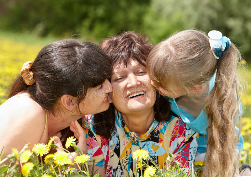 Grandmother, daughter and granddaughter outdoors. stock photography