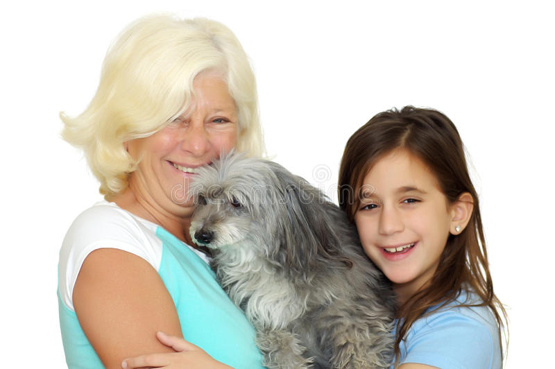 Download Grandmother And Girl Hugging The Family Dog Stock Photo - Image: 19256490