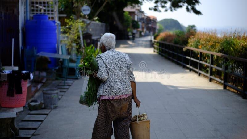Grandmother going to morning market stock photos