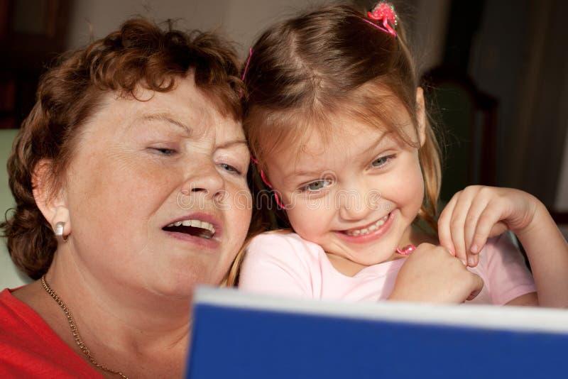 Grandmother and grandchild reading