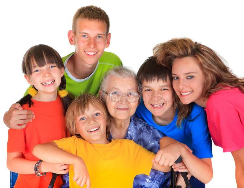 Grandmother and grandchildren. Colorful family portrait of Grandmother surrounded by her five smiling grandchildren on white background stock image
