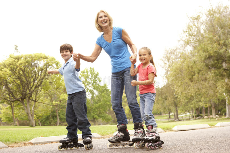 Download Grandmother And Grandchildren Skating In Park Stock Photo - Image: 11502130