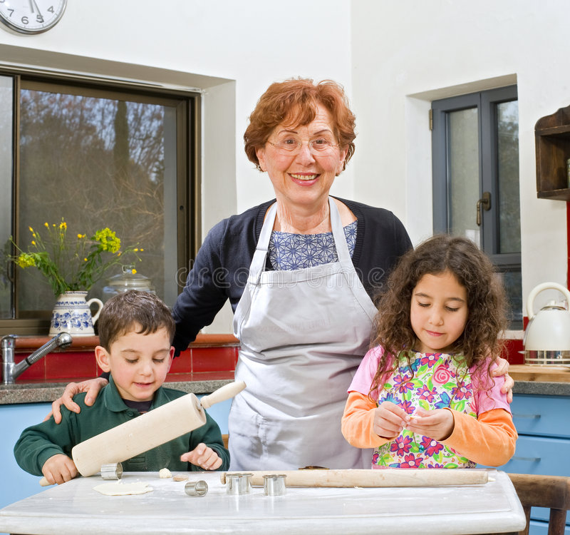 Grandmother and grandchilds baking royalty free stock image