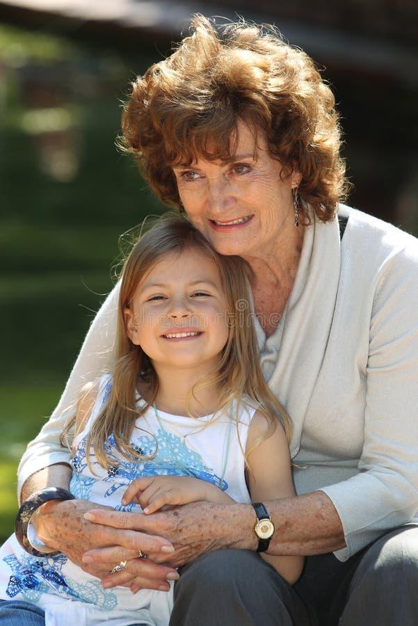 Download Grandmother And Granddaughter Stock Image - Image of older, cuddling: 14299089