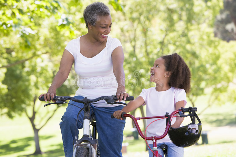 Download Grandmother And Granddaughter On Bikes Outdoors Stock Photo - Image: 5469734