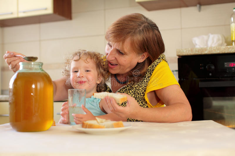 Download Grandmother With The Granddaughter Eating Honey Stock Image - Image: 10262857