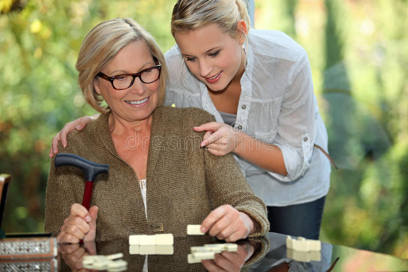 Grandmother and granddaughter playing royalty free stock photo