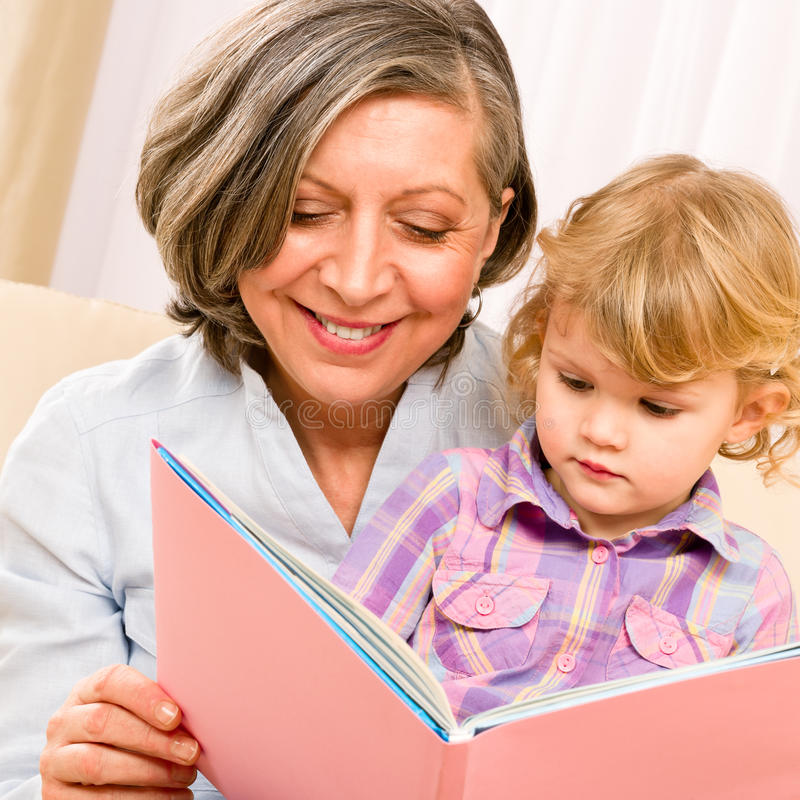 Download Grandmother And Granddaughter Read Book Together Stock Photo - Image: 23024106
