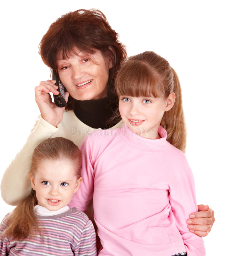 Grandmother and granddaughter talk on phone. stock photos
